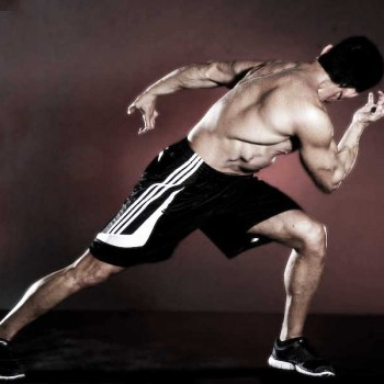 Martial Arts Conditioning Exercise Tiger stretches his back twisting torso with arms rotating in bow stance