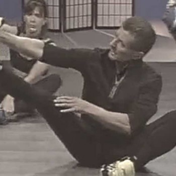 Kickboxing stretching image extending left foot out and pulling ball of foot