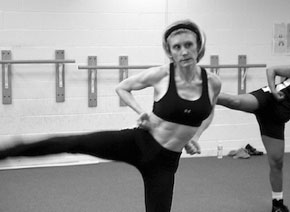 Kickboxing dvd workout with person performing a side kick